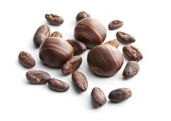 chocolate pralines and cocoa beans - stock photo