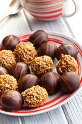 chocolate pralines in plate - stock photo