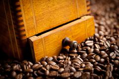 Detail of antique coffee mill Stock Photos