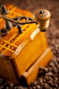 detail of antique coffee mill - stock photo