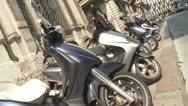 Stock Video Footage of Mopeds parked on a street in Milan