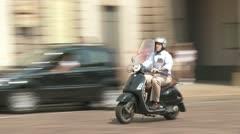 Italian Mopeds in Milan street Stock Footage