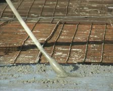 Bricklayers pouring concrete Stock Footage