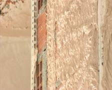Bricklayer plastering wall, close up - stock footage