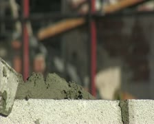 Bricklayer putting cement - stock footage