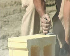 Bricklayer cutting a brick with grinder - stock footage