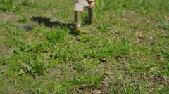 (Slow Motion) Young boy plays in the yard 2 Stock Footage