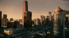 Sunset business skyscraper district,aerial view of traffic in city. Stock Footage