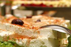 Cattering white cheese - stock photo