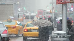 Snow falling in New York City crowd walking slow motion 30p - stock footage