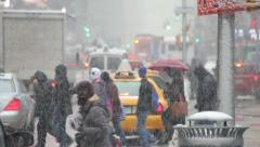 Snow falling in New York City crowd walking 30p - stock footage
