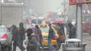 Stock Video Footage of Snow falling in New York City crowd walking 30p