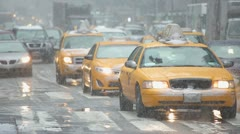 Snow falling in New York City yellow cabs cars traffic 30p Stock Footage