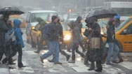 Snow falling in New York City crowd walking slow motion 30p Stock Footage