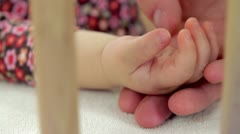 Closeup of baby's hand when his father touch it Stock Footage