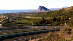 Distant view of Gibraltar from Spanish approach road Stock Footage