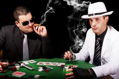 two gangsters playing some cards - stock photo