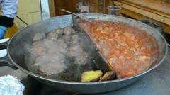 Potato meat vegetable stew bake huge pan outdoor restaurant Stock Footage