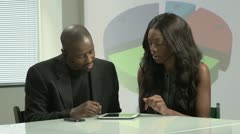 Two business employees briefing with a tablet Stock Footage
