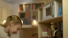 Girl playing with toy kitchen Stock Footage