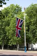 flagpole with british flag - stock photo