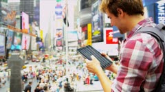 Young Male Wireless Tablet Sightseeing New York Times Square Stock Footage