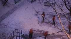 Street cleaners in orange uniform removing the snow. Time lapse. Stock Footage