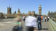 Crowds of people and traffic on Westminster Bridge, London - stock footage