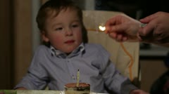 Kid's birthday. Boy blows out the candle in the tiramisu cake. Stock Footage