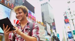 Caucasian Male Backpacker Tablet Times Square USA Stock Footage