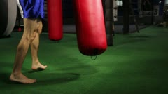 Muay Thai fighter knees heavy bag Stock Footage