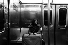 Woman with suitcase in new-york subway Stock Photos