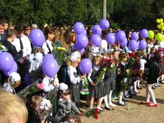 Children with flowers and balloons on a holiday of the 1st september Stock Photos