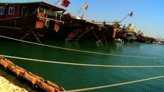 Wooden Dhows Anchored Harbourside Persian Gulf - stock footage