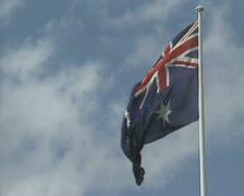 Australian flag waving in blue sky white cloud Stock Footage