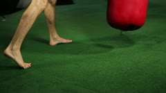 Muay Thai fighter shows footwork when hitting heavy bag - stock footage
