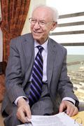 Senior businessman smiling away Stock Photos