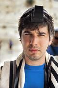 jewish tourist portrait at the western wall - stock photo