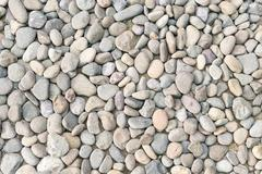 Pebble heap as abstract natural background. Stock Photos