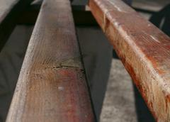 Wooden bench in a park Stock Photos