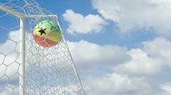 Ghana ball scores in slow motion with sky background Stock Footage