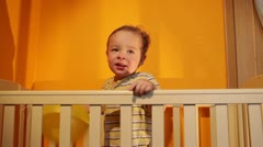 Boy plays with balloon in the playpen. Stock Footage