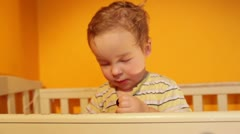 Portrait of the boy playing in the playpen. Stock Footage