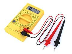 yellow digital multimeter on white background - stock photo