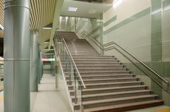 columns and a stairway at a subway station underpass - stock photo