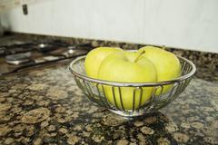 Bowl of green apples Stock Photos