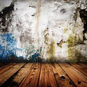 old grunge wall and wooden floor in a room - stock photo