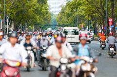 busy street in ho chi minh city. vietnam. - stock photo
