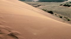 Sand floating over big daddy dune at soussuvlei,namibia,africa Stock Footage