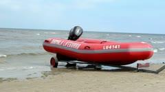 Stock Video Footage of jurmala lifeguard motor boat sea coast people recreate